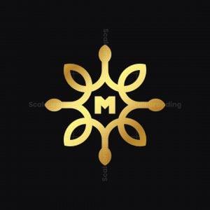 Golden Ornament M Logo